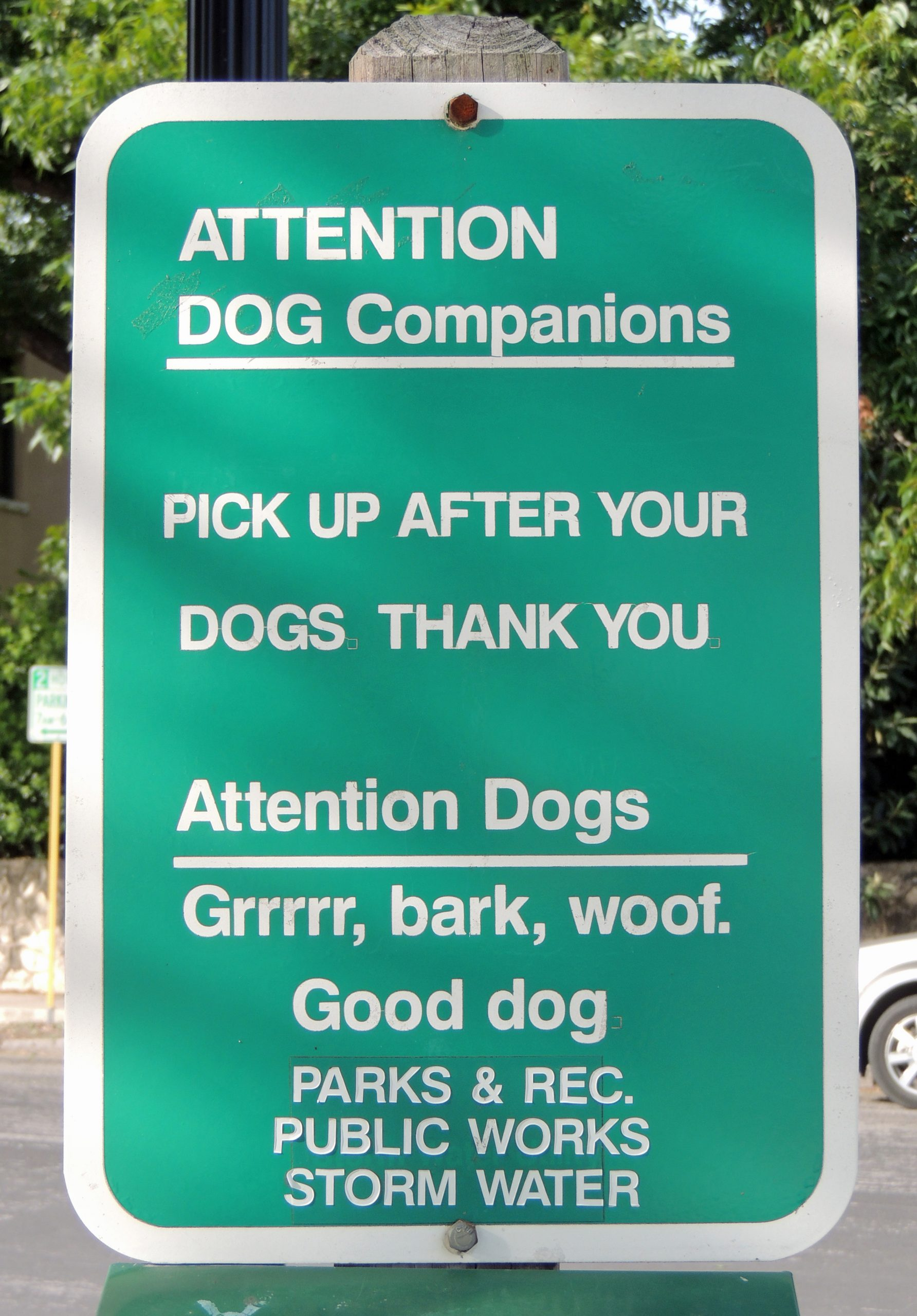 Sign in King William Park for dogs and their human companions. Photo by Charlotte Luongo.