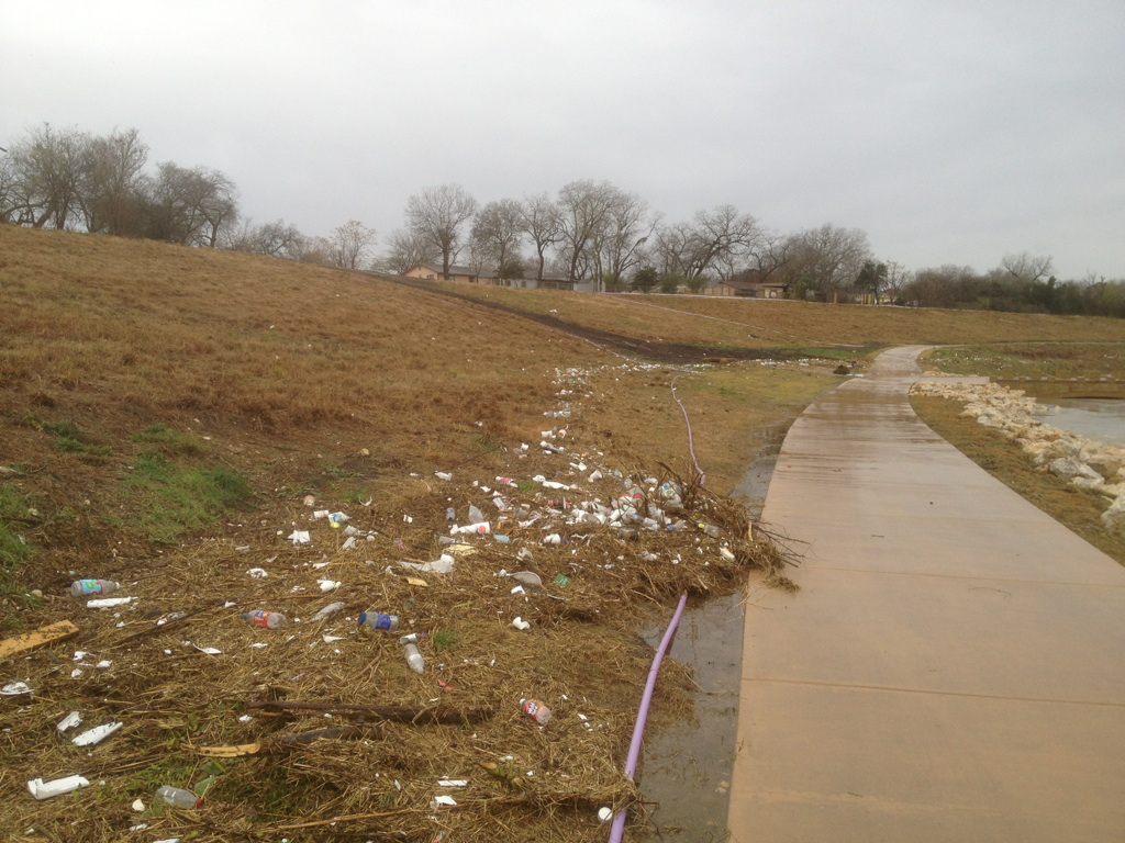 High water flow leaves behind litter along the Mission Reach trail after flooding. Each citizen can do their part to keep the river clean by making sure they properly dispose of trash and recyclables. Photo courtesy of SARA.
