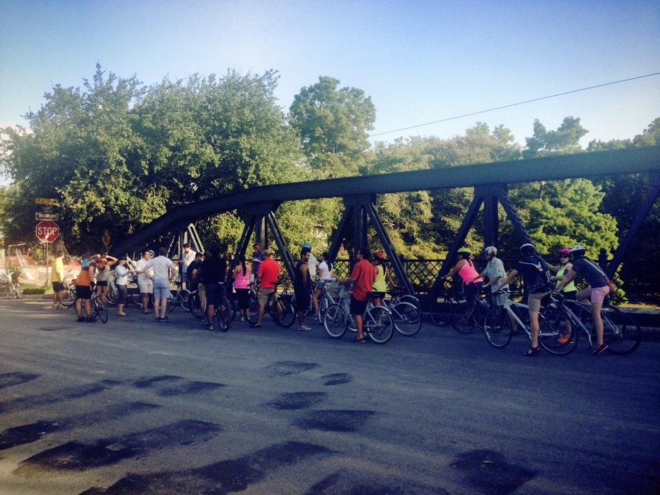 The Something Monday crew stops to listen to a wabiStory about the Arsenal Street Bridge. Photo by Kelly Beevers.