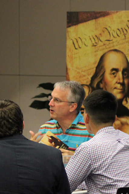 Christopher Phillips talks with fellow dinner guests about present-day uses and interpretations of the U.S. Constitution. Photo by Sarah Hedrick.