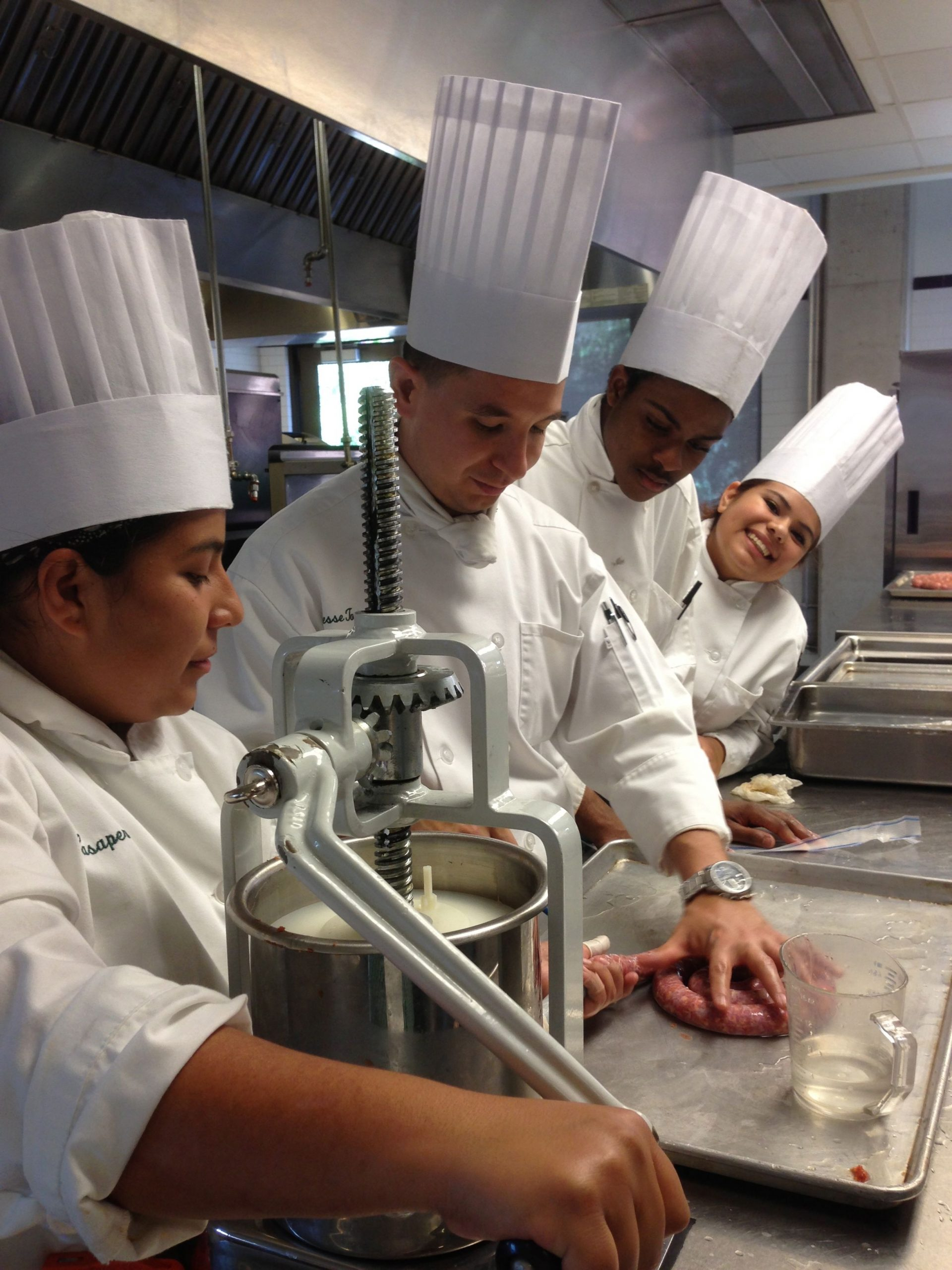 Jesse Torres and classmates making sausage during their coursework at CIA. Courtesy of Jesse Torres.