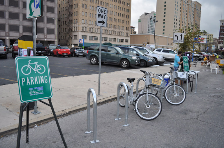 """MPO and the Office of Sustainability sponsored a spot at PARK(ing) Day Sept. 27 titled """"Twelve to One."""" The intent was to show that 12 bicycles could fit in the same space as one vehicle. (Photo by Annette Crawford)"""