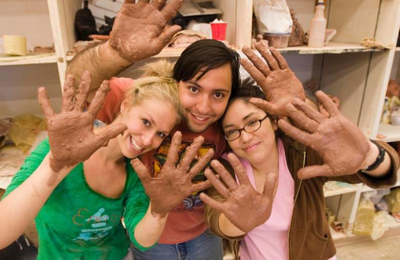 Students pose for a photo during a ceramics lab. Courtesy of UTSA.