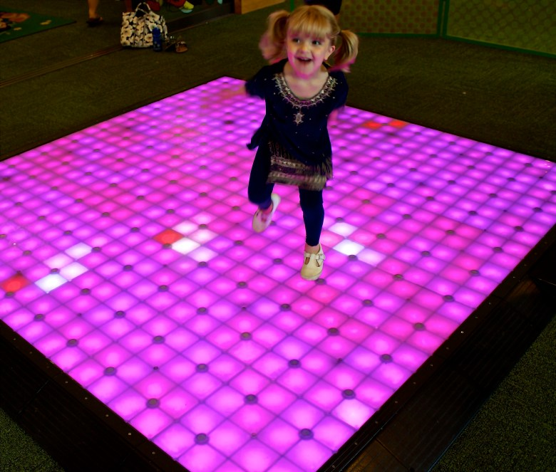 An interactive light board encourages kids to play and be more active.