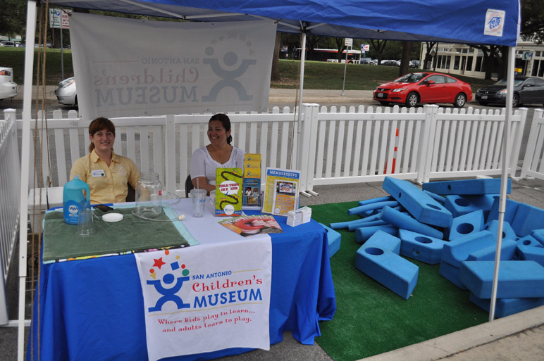 Mary Compton, left, and Miki Rubio await visitors at the San Antonio Children's Museum spot at PARK(ing) Day. Photo by Annette Crawford.