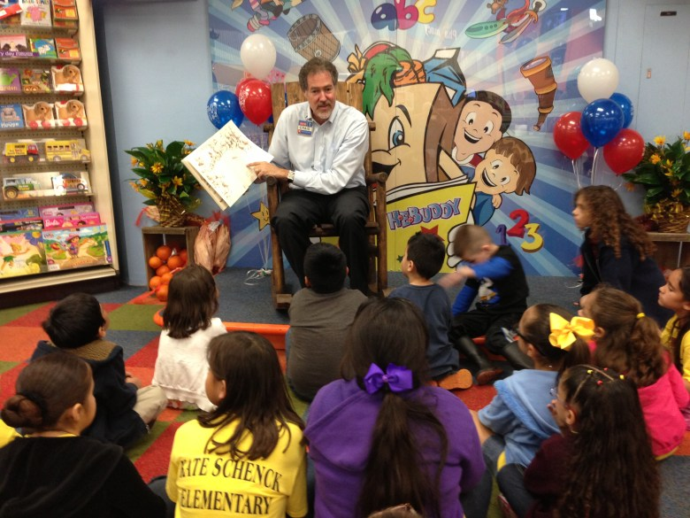 H-E-B President and COO Craig Boyan reads to children to kick off the two week book drive.