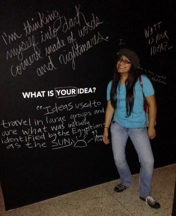 Amanda Flores stands tall beside her idea
