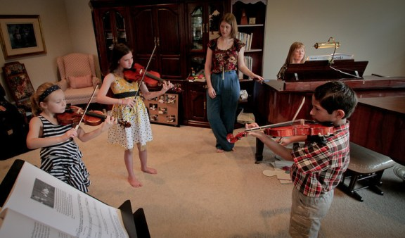 A group lesson led by Aimee Toomes (center) with Janet Toomes, Aimee's mother on piano, Kaitlyn Woodward (left), Destiny Kniseley, and Emilio Veana (right). Photo courtesy of Matt Diekman.