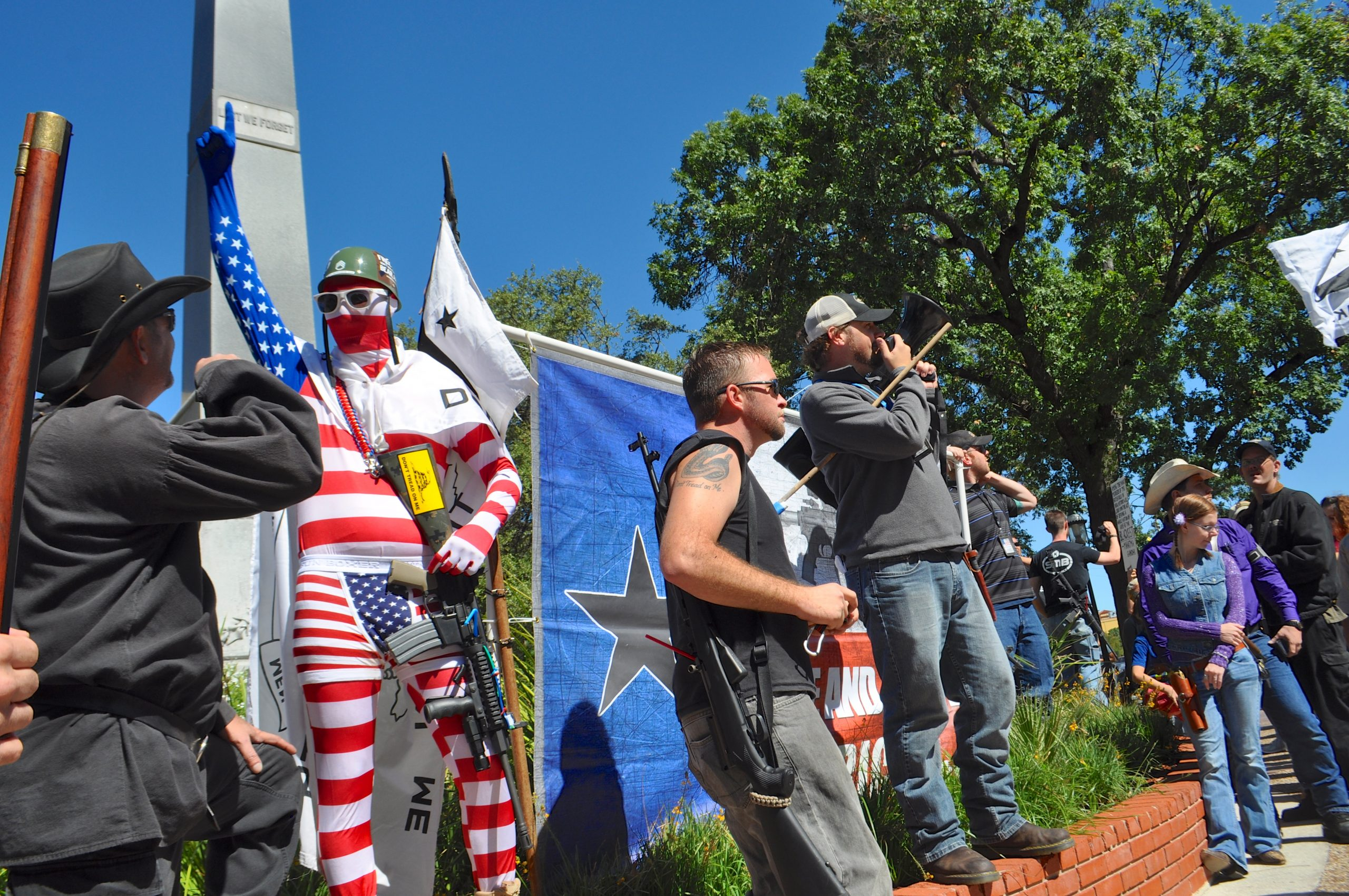 Citizens take to the megaphone during the less formal rally in Travis Park. Photo by Iris Dimmick.
