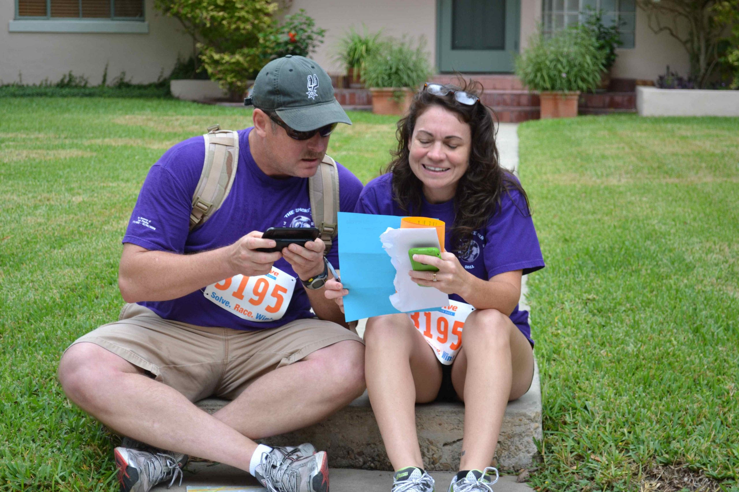 Teammates participating in the UrbanSolve City Race read and answer clues for the next checkpoint. Photo by Steve Wood.