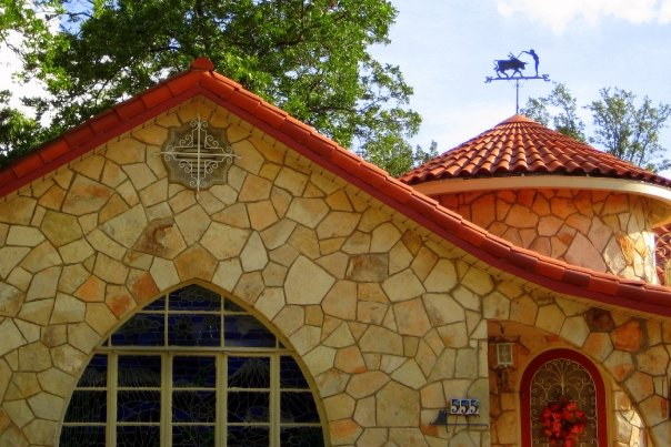 Amazing stonework, circular entry – and check out that weather vane. Photo by Jeff Reininger.