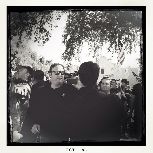 Alex Jones speaks to supporters at the gun rally in Alamo Plaza. Photo by Leslie Kelly.