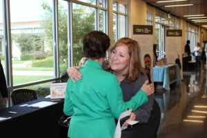 Rebecca Helterbrand of Clarity greets an arriving guest at Monday's event. Photo by Sarah Hedrick.
