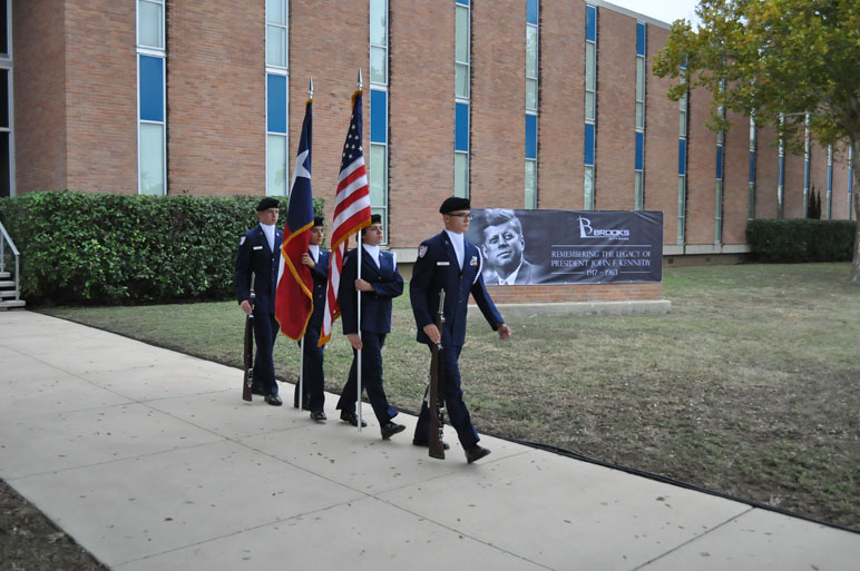 The Brandeis High School Air Force Junior ROTC color guard marches to the JFK memorial ceremony at Brooks City-Base. Photo by Annette Crawford