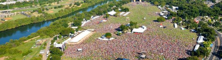 Austin City Limits Festival as seen from the air. Held annually at Zilker Park this year saw Depeche Mode, Atoms For Peace and 130+ other aritsts. C3 booked only 1 band here in San Antonio compared to 16 in Dallas and 7 in Houston. Photo via austintexas.gov.