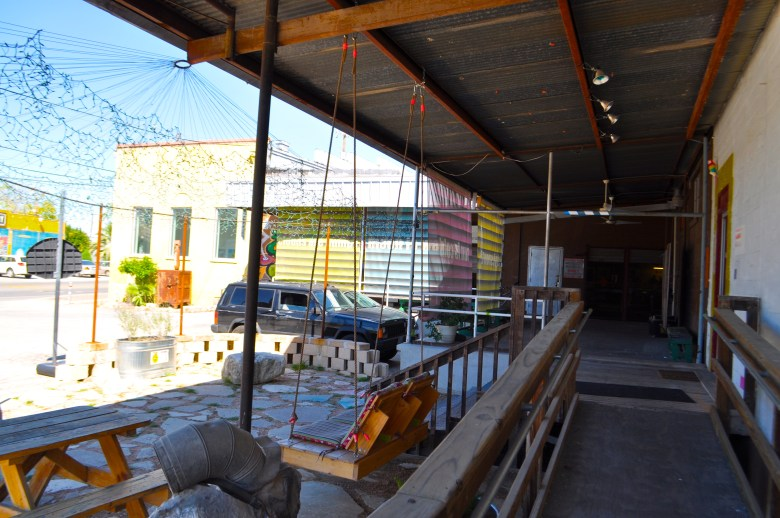 The patio space connecting studios and galleries on S. Flores at Lone Star Blvd. host Second Saturday. Tonight, this will be packed with artists, patrons, and friends enjoying music, beer, and (of course) art. Photo by Iris Dimmick.