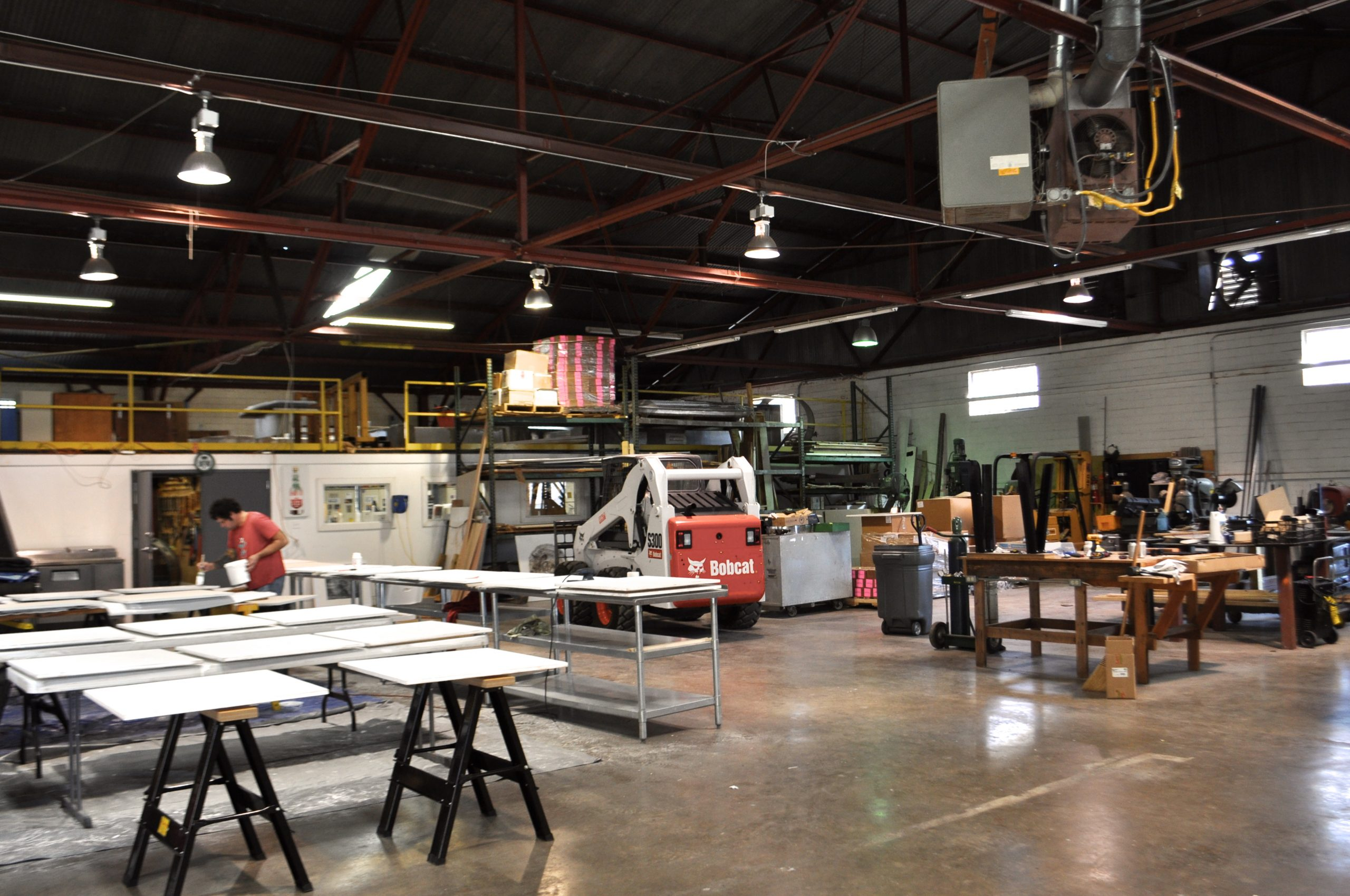 """Bill FitzGibbons' warehouse-like studio space at times feels more like a construction zone than an art studio. """"The size of your studio affects the size of your art,"""" FitzGibbons said. Photo by Iris Dimmick."""