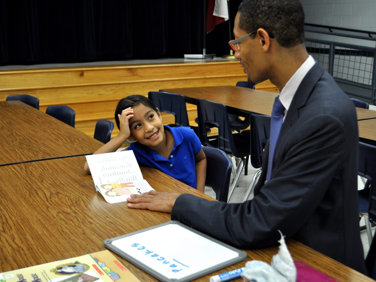 Diamond smiles at the completion of yet another book with her reading buddy Darryl Byrd. Photo by Iris Dimmick.