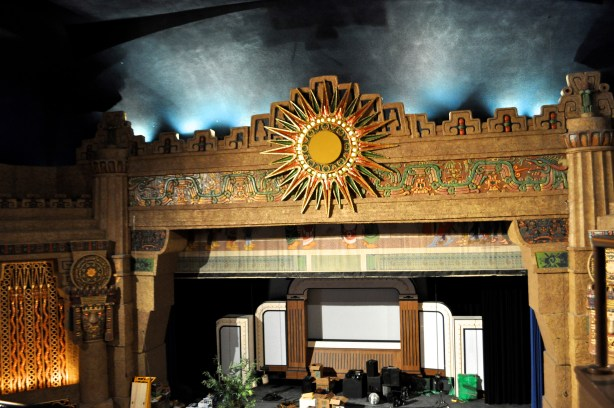 """The Aztec Theatre stage. The back drop on stage, left over from the """"San Antonio Rose Live,"""" a Branson-style classic country music show, will be removed to allow for more space. Photo by Iris Dimmick."""