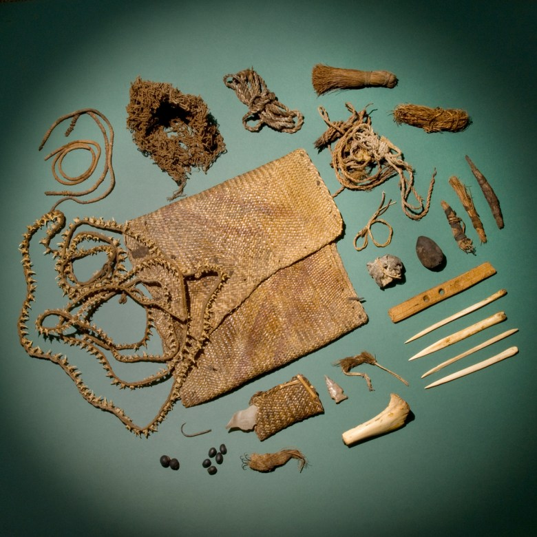Shaman's bag on display with all its contents – thousands of years old – spread out. Photo by Al Rendon.