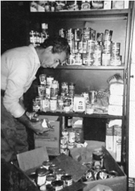 One of the first volunteers of Inner City Development (founded in 1968) stocking the Food Pantry.