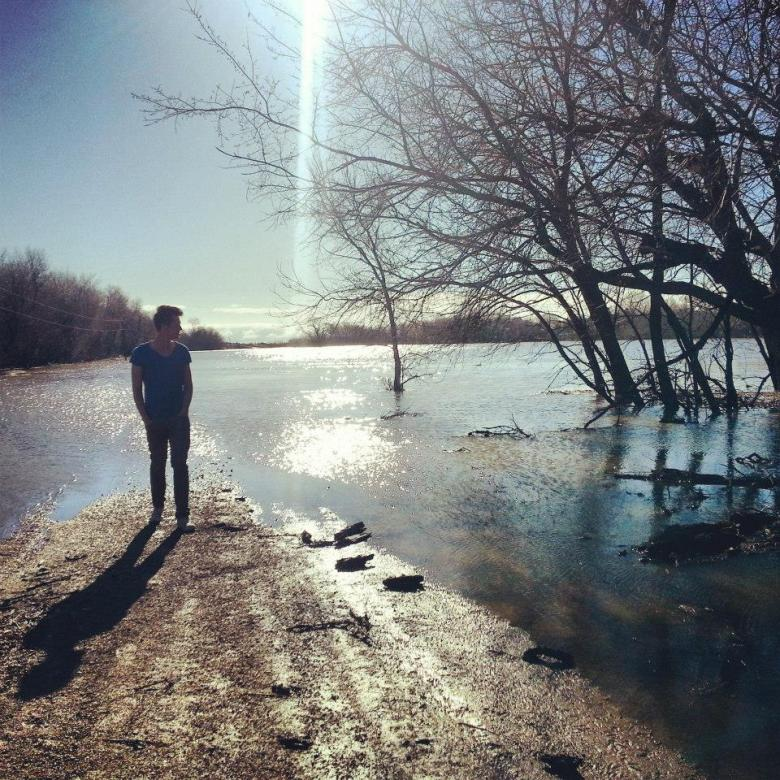Jean-Luc Mette checking out floodwaters in North Dakota, right behind the family farm. Courtesy photo.