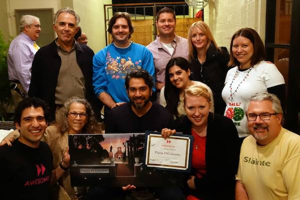 Roberto Treviño of Little Italy holds his $1000 grant and a rendering of the Piazza Di Columbo for a photo with Awesome SA Trustees and Deans. Courtesy Photo.