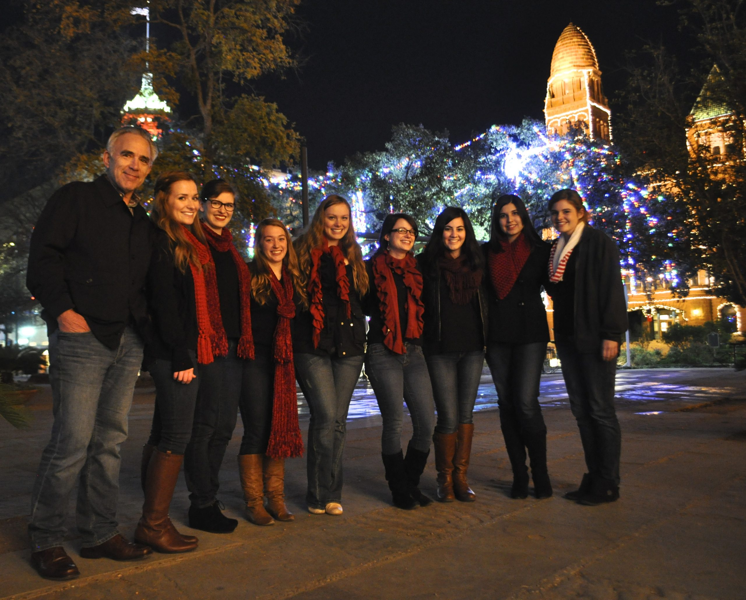 Robert Rivard stands with The AcaBellas after their Something Monday performance in Main Plaza. Photo by Iris Dimmick.