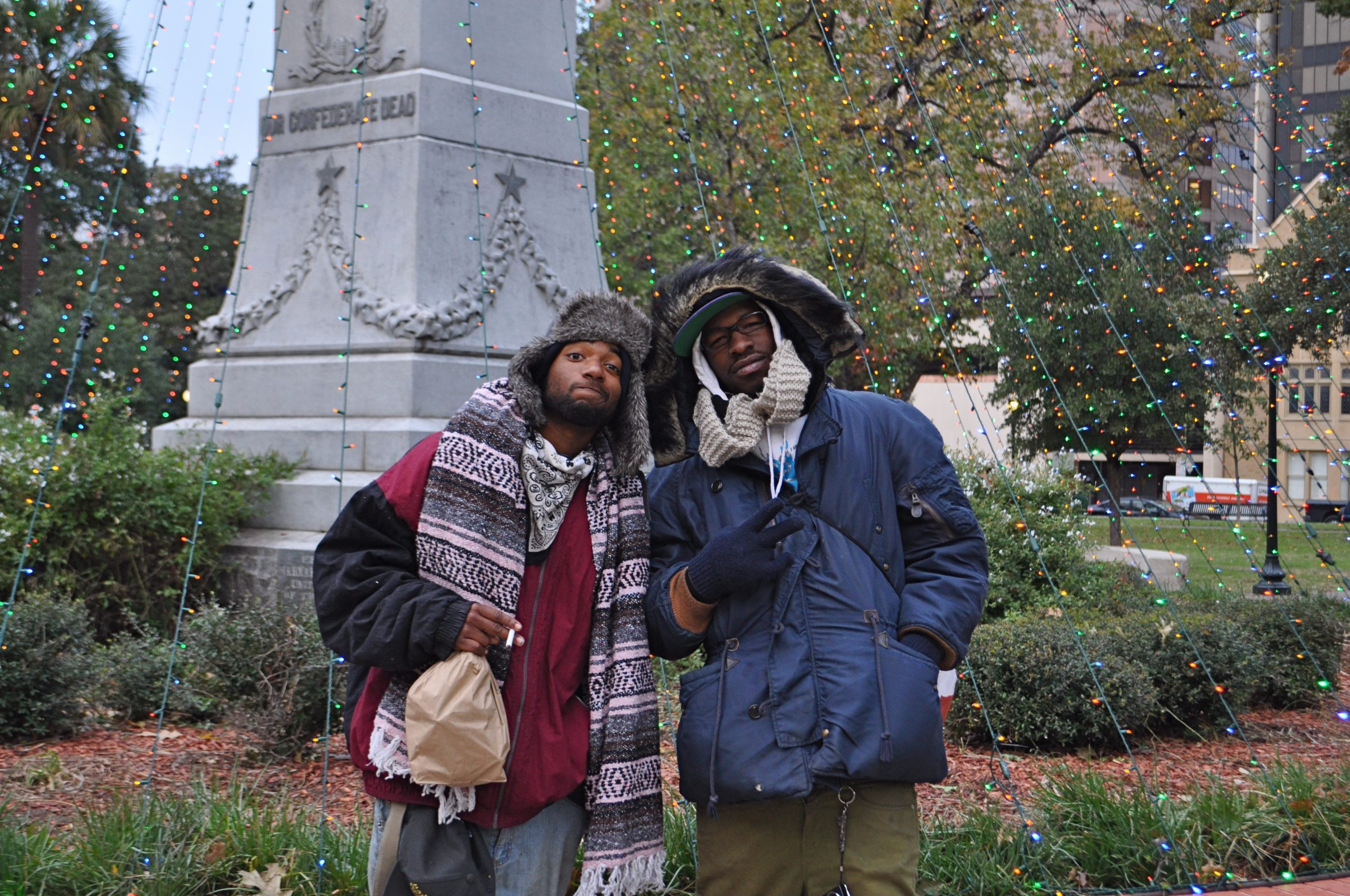 Locals Chief (left) and Red bundled up in Travis Park on a cold afternoon in San Antonio. Red said he was lucky enough to find a solid winter coat, Chief's wind breaker leaves much to be desired when temperatures drop below 30 degrees at night. Photo by Iris Dimmick.