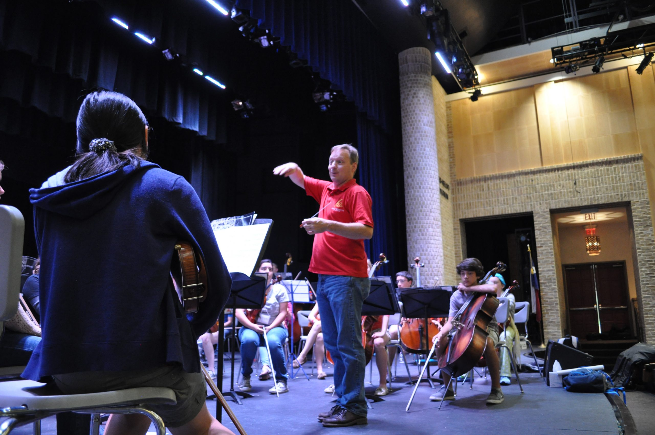Ken Freudigman, principal cello in the San Antonio Symphony, directs the YOSA symphony orchestra. Photo by Iris Dimmick.