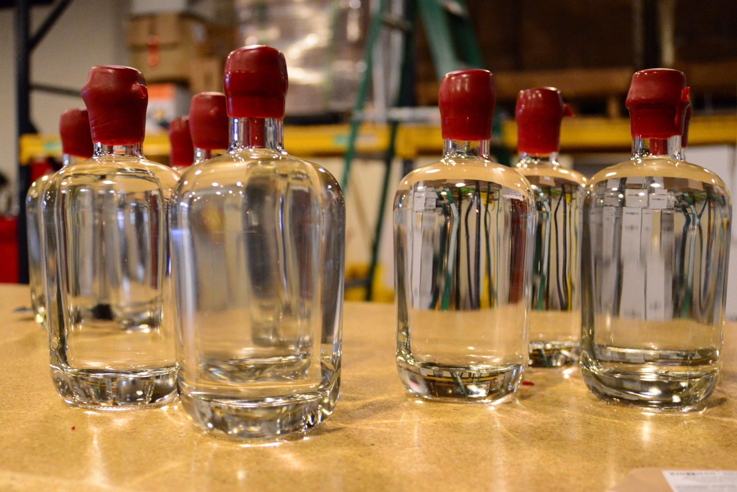 Bottles of Kinsman Rakia await labeling. Photo by Page Graham.