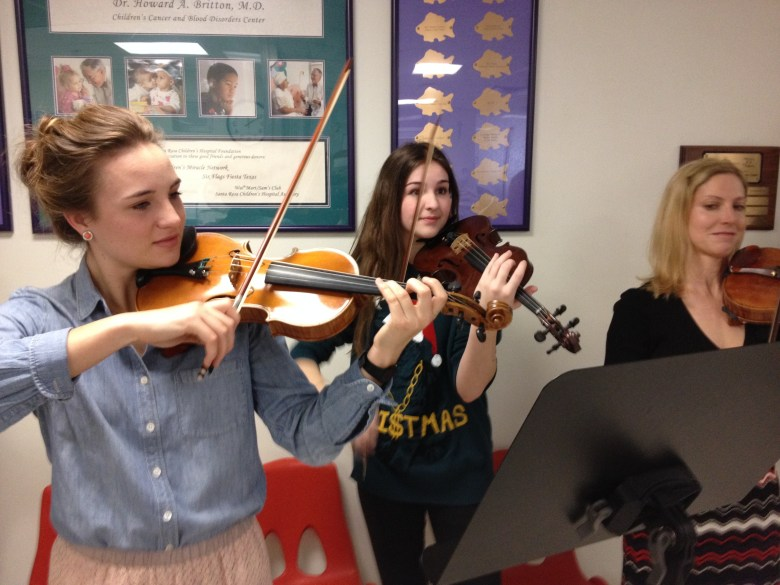 Students Marian Amini and Rebecca Ward join Symphony Violinist Amy Venticinque, their longtime teacher and mentor. Photo by Robert Rivard