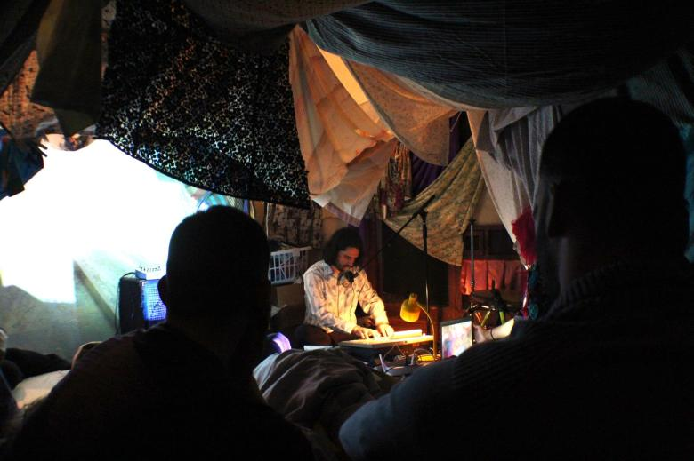 Local performer Ghost Electric in the blanket fort somewhere in Monticello Park, San Antonio. Photo taken by Veronica Salinas.