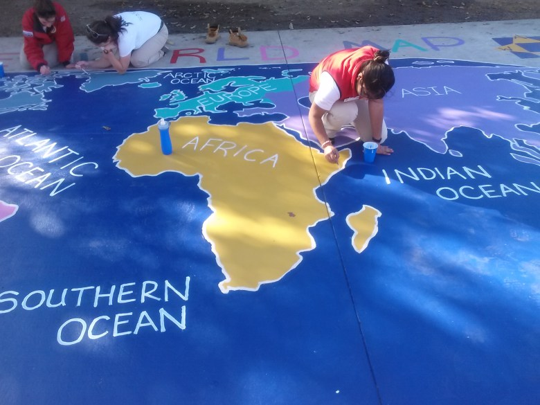 City Year Corps Members create a world map for the students at Martin Luther King Academy. Photo by Sasha Boudreaux.