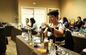 """Charla Marsh measures out ingredients for a classic rum Daiquiri during """"Mixology 101"""" at the 2014 San Antonio Cocktail Conference. Photo by Iris Dimmick."""