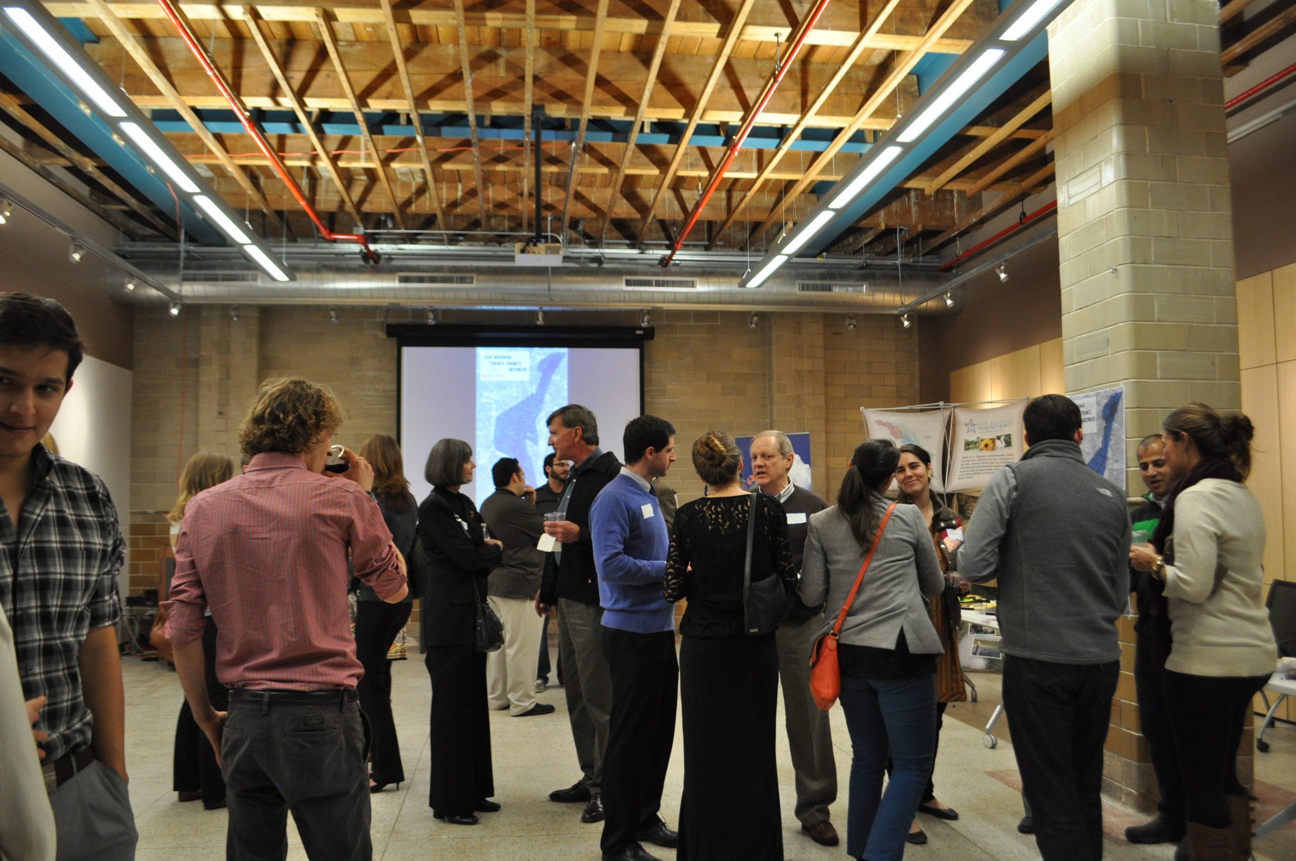 Attendees mingle as the San Antonio 2030 District launch party winds down at the AIA San Antonio office. Photo by Iris Dimmick.