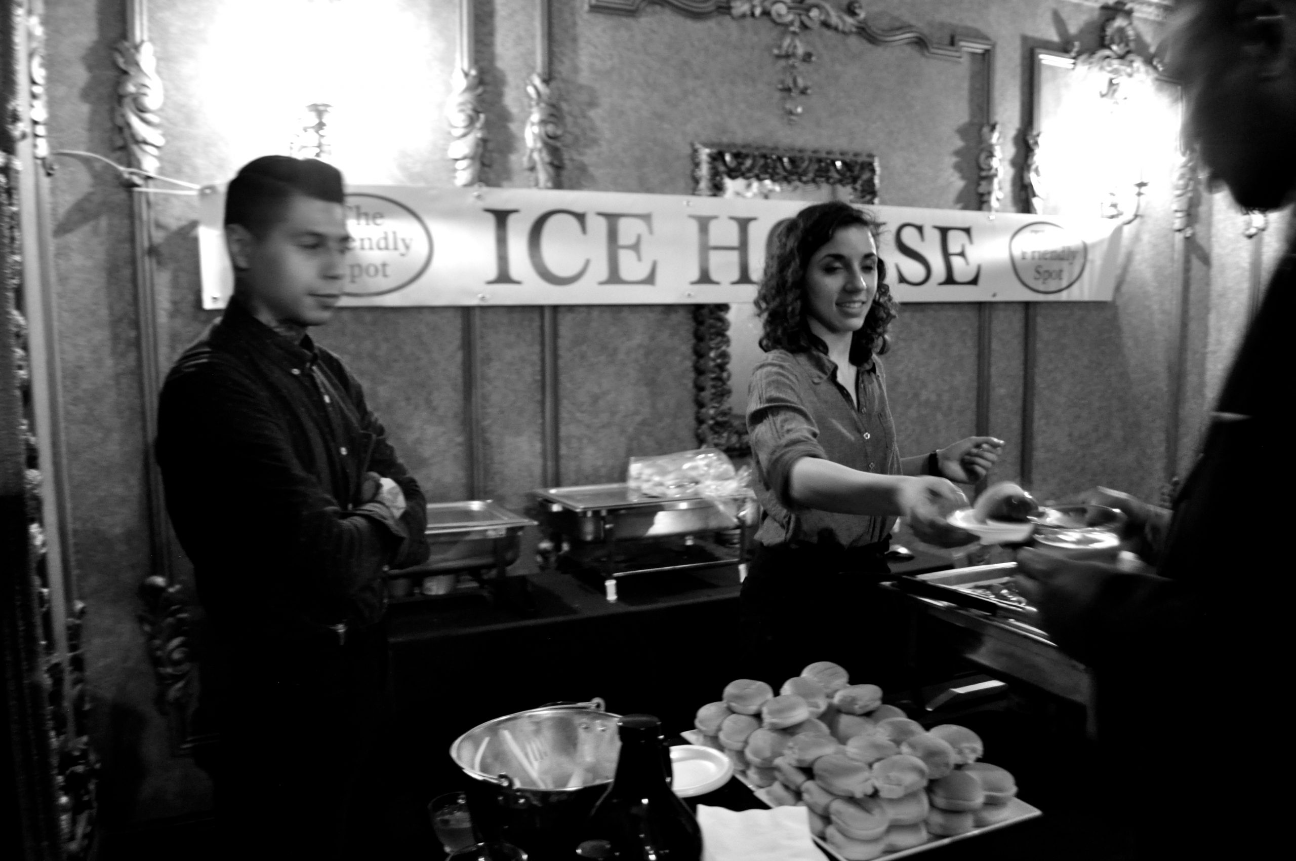 Cisco Garcia (left) and Jessica Rivera serve up meatballs made with Fireman's #4 blonde ale. Photo by Iris Dimmick.