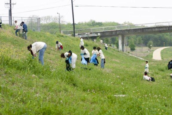 Volunteers fan out to collect trash along the San Antonio River during the 2013 Basura Bash. Photo courtesy Basura Bash.