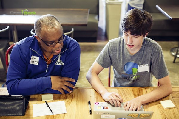 COSA Sr. IT Manager Llew Fambles works with High School Junior & Tech Entreprenur Joshua Singer of Apps for Aptitude during a breakout session.