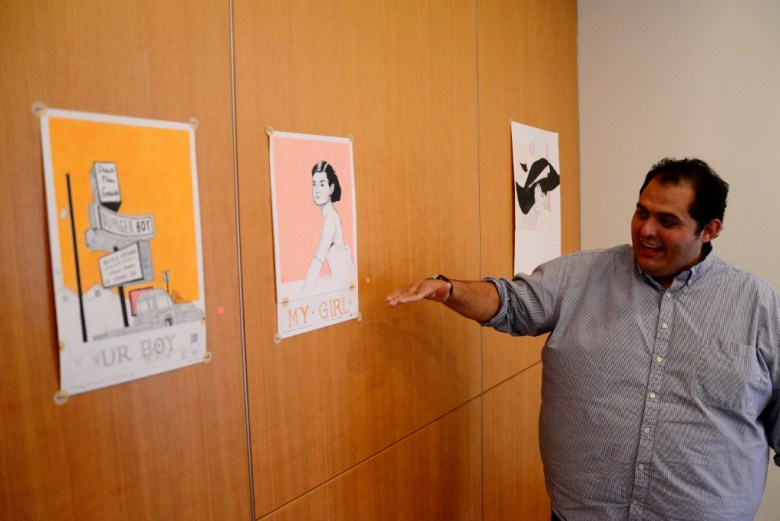 Rex Hausmann shows off conceptual sketches commissioned by the McNay Art Museum, 2014. Photo by Page Graham.