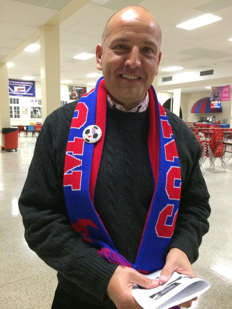 Ed Garza sports a Jefferson Mustangs soccer scarf.