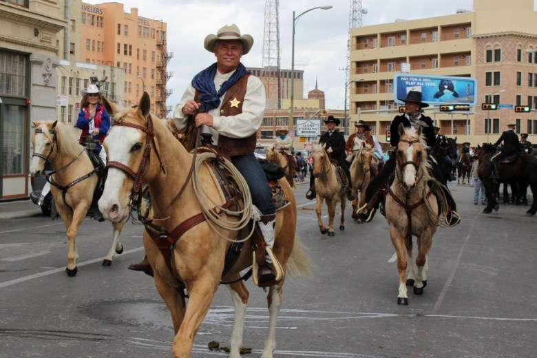 Riders gather up on Alamo Street waiting to return down Houston Street to the parade staging area. Photo by Page Graham.