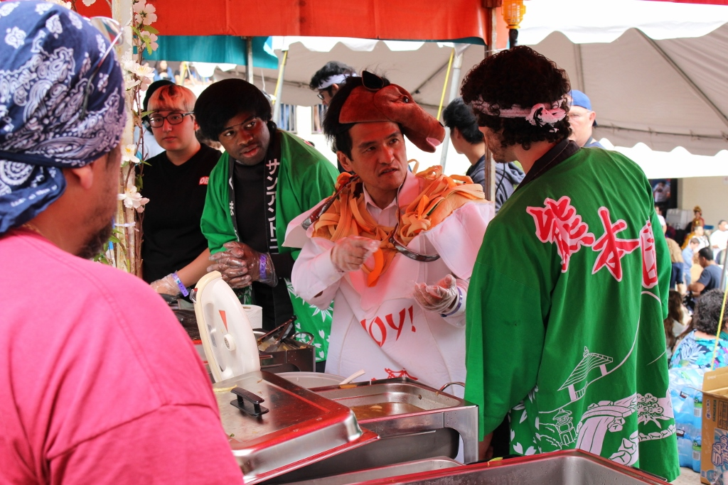 Don't let the horse on his head fool you...this gentleman takes his Yakitori very seriously! Photo by Page Graham.