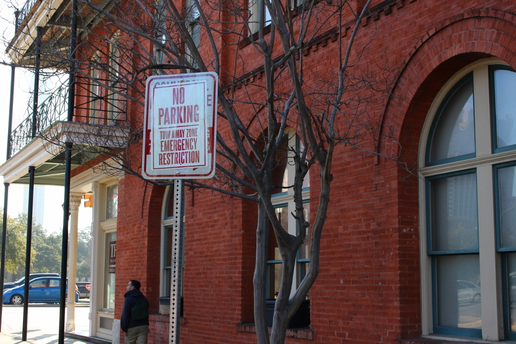 """Seemingly permanent """"Emergency Restrictions"""" exist throughout the CBD, including next to Artpace, behind the Majestic Theater, and this one next to the Fairmount Hotel. Photo by Page Graham."""
