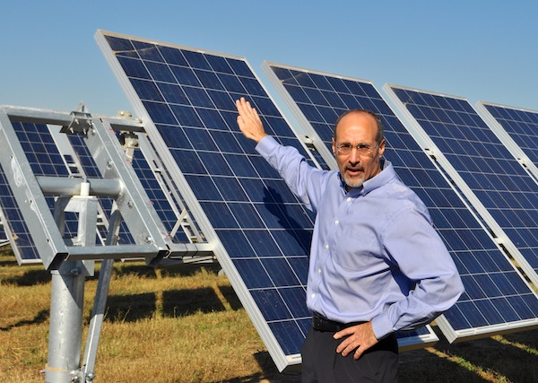 OCI Solar Power President and CEO Tony Dorazio explains how the dual-axis tracks and sophisticated sensors follow the angle of the sun for maximum efficiency. Photo by Iris Dimmick.