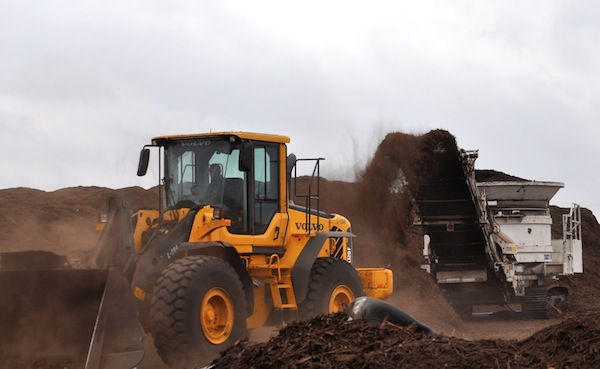 Dozens of dirt and compost piles occupy the 120 acres that make up New Earth, Inc., a local compost plant. Photo by Iris Dimmick