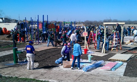 An army of KaBOOM volunteers converge onto Brooks Park to assemble a new playground. Photo by Andrew Moore.