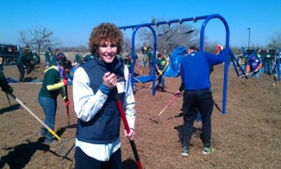 Human Chief Consumer Officer Jody Bilney pauses for a photo while volunteering at Brooks Park. Photo by Andrew Moore.