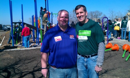 KaBOOM Founder and CEO Darell Hammond (left) and Humana President and CEO Bruce Broussard pose for a photo while they and their teams build a new playground at Brooks Park. Photo by Andrew Moore.