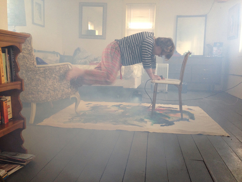 Trying to levitate over a painting, 2013. Photo courtesy Christie Blizard.
